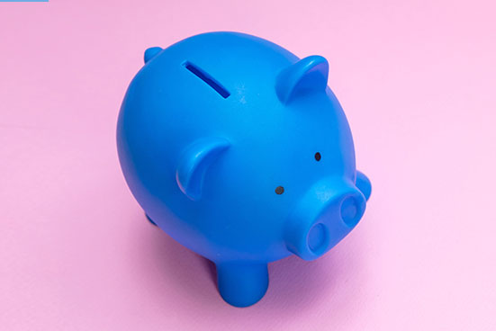 blue piggy bank with pink background